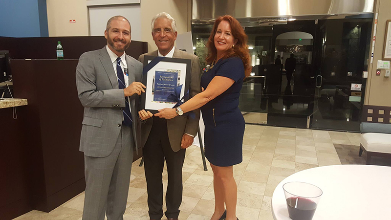 BKF Partner, Michael Weitz accepted the 100% alumni participation and Blanchard Krasner French Annual and Endowed Scholarship